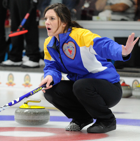 Alberta vice-skip Heather Jensen calls off the sweeping in her team's win over B.C. (Photo, CCA/Claudette Bockstael, Studio C Photography)