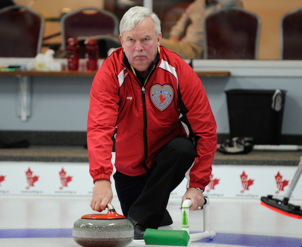 Newfoundland/Labrador skip Gary Oke delivers a rock during Thursday's game at the Canadian Mixed Pre-Qualifying round in Ottawa.