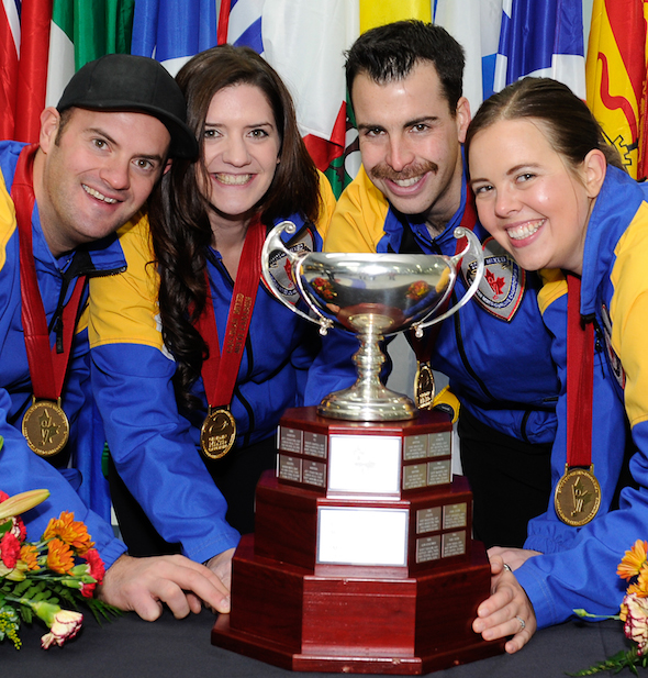Team Alberta, from left, skip Darren Moulding, vice Heather Jensen, second Brent Hamilton and lead Anna-Marie Moulding celebrate their Canadian championship.  (Photo, CCA / Claudette Bockstael, Studio C Photography)
