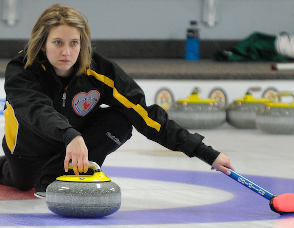 Team New Brunswick skip Sylvie Robichaud delivers rock during her win on Tuesday. (Photo, CCA/Claudette Bockstael, Studio C Photography)