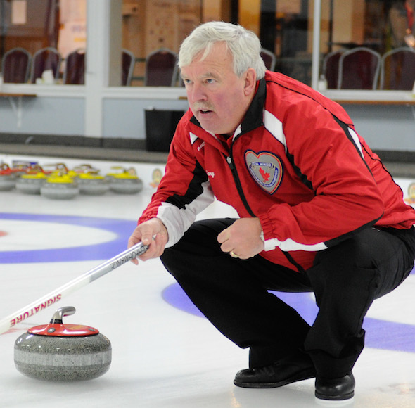 Newfoundland/Labrador skip Gary Oke instructs his sweepers during his win over the Northwest Territories on Monday. (Photo, CCA/Claudette Bockstael, Studio C Photography)
