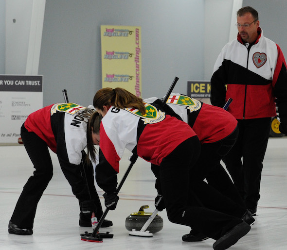 Ontario skip Cory Heggestad, right, looks on as his team drags a rock into the rings during their tiebreaker win over New Brunswick. (Photo, CCA/Claudette Bockstael, Studio C Photography)