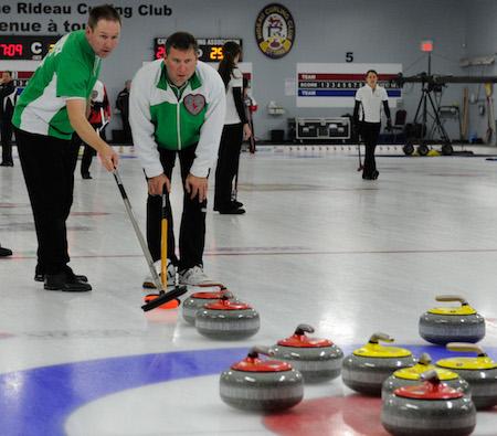 Saskatchewan skip Shaun Meachem, right, discusses options with second Carl deConinck Smith during Wednesday night's win.  (Photo, CCA/Claudette Bockstael, Studio C Photography)