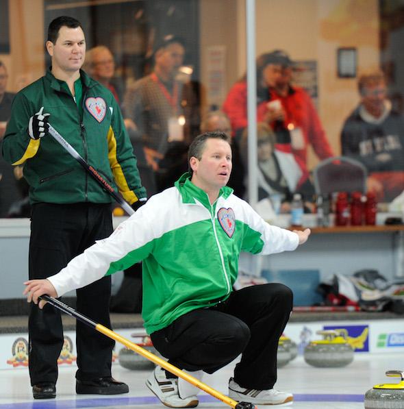 Saskatchewan skip Shaun Meachem, right, clinched a semifinal berth by beating Northern Ontario's Charlie Robert on Friday.  (Photo, CCA/Claudette Bockstael, Studio C Photography)