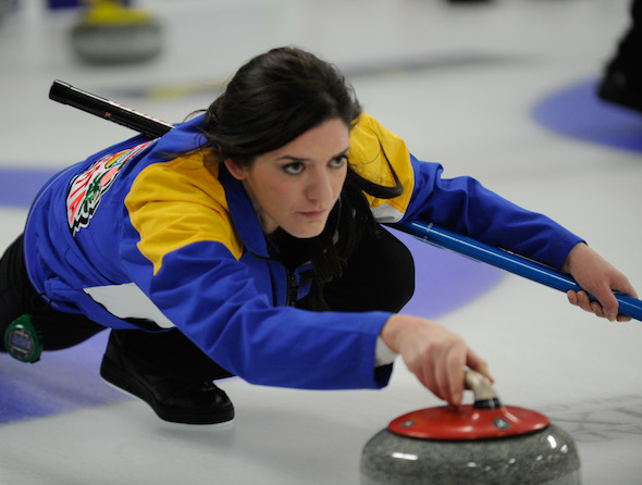 Alberta vice-skip Heather Jensen concentrates on her shot during Tuesday night's win in Ottawa.  (Photo, CCA/Claudette Bockstael, Studio C Photography)