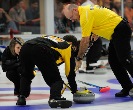New Brunswick skip Sylvie Robichaud, left, directs sweepers Marcel Robichaud, middle, and Lloyd Morrison on Tuesday night. (Photo, CCA/Claudette Bockstael, Studio C Photography)
