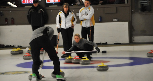 Heather Smith calls as John Morris sweeps in action on Friday at the Canadian Mixed Doubles Curling Trials (Photo John Schwartzburg)