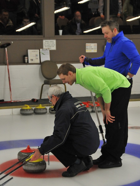 Adam Casey and Tom Sullivan watch closely as official Roger Gregoire completes a measurement (Photo John Schwartzburg)