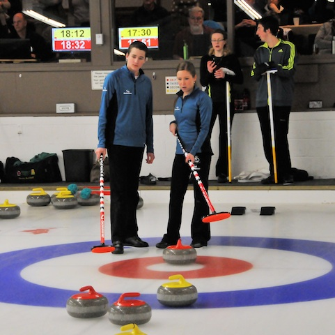 Connor and Kaitlyn Lawes in action during Day 2 action at the 2014 Canadian Mixed Doubles Curling Trials (Photo   )