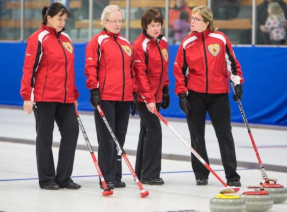 Team Newfoundland and Labrador ponders the next shot (Photo James MacKenzie)