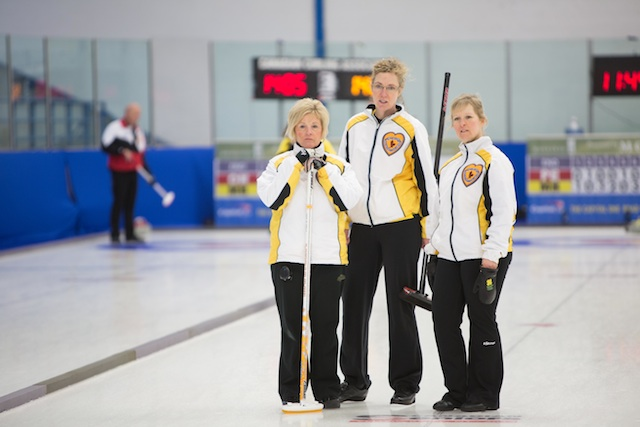 Manitoba skip Lois Fowler (left) confers with Maureen Bonar and Cathy Gauthier during their game at the 2014 Canadian Senior Curling Championships (Photo James MacKenzie)
