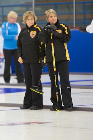 New Brunswick's Judy Blanchard and Jane Arseneau keep watch during their Draw 7 game at the 2014 Canadian Senior Curling Championships in Yellowknife (Photo James MacKenzie)