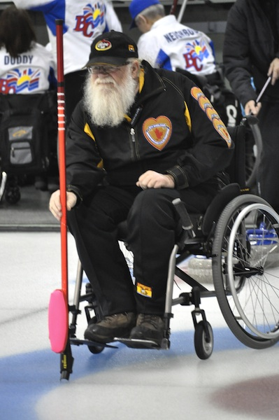 New Brunswick's Michael Fitzgerald holds the broom in the team's first win at the 2014 Canadian Wheelchair Championship (Photo Morgan Daw)