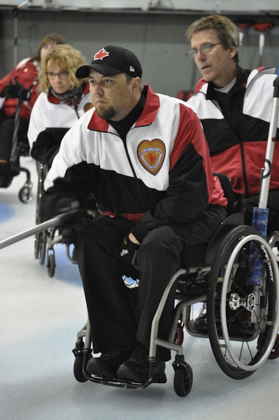 Ontario's Mike Munro delivers his rock during Draw 9 action at the Canadian Wheelchair Curling Championship in Boucherville, Que. (Photo Morgan Daw)