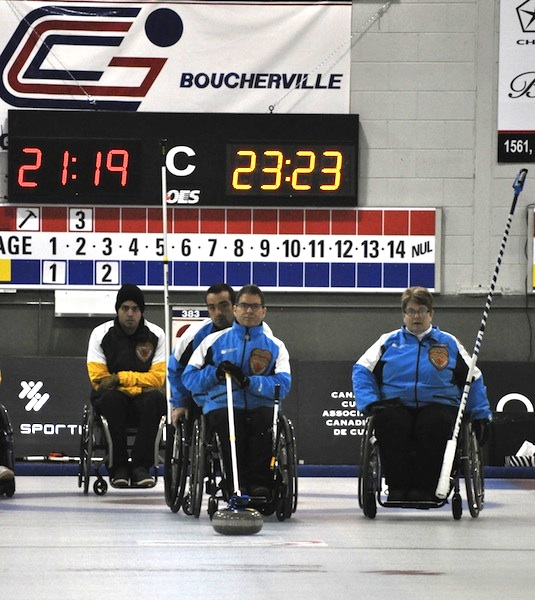 Team Quebec skip Benoit Lessard prepares to deliver his rock at the 2014 Canadian Wheelchair Championship in Boucherville, Que. (Photo Morgan Daw)
