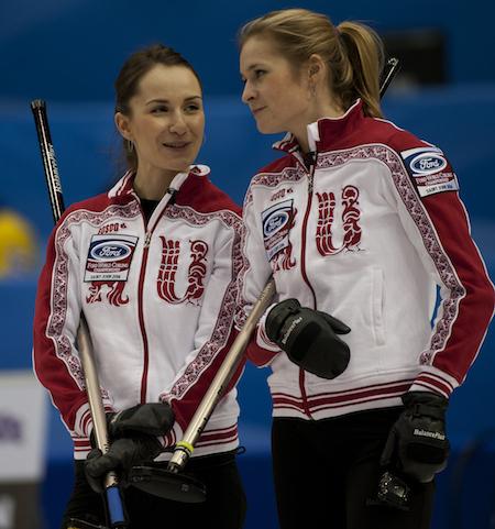 Russia's Anna Sidorova, left, and Margarita Fomina enjoyed their win over Latvia on Saturday night. (Photo, CCA/Michael Burns)