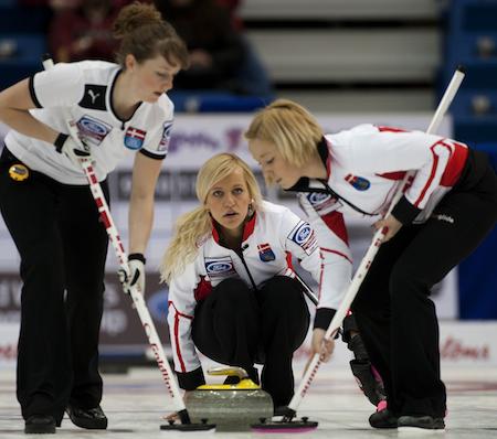 Danish skip Madeleine Dupont looks on as seeepers Lina Knudsen, left, and Christine Svensen go to work. (Photo, CCA/Michael Burns)