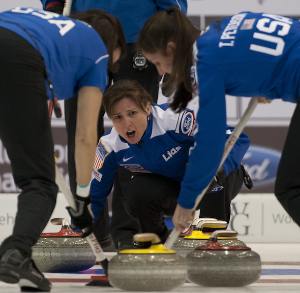 Team U.S.A. skip Allison Pottinger instructs sweepers Natalie Nicholson, left, and Tabitha Peterson during win over Germany on Sunday. (Photo, CCA/Michael Burns)
