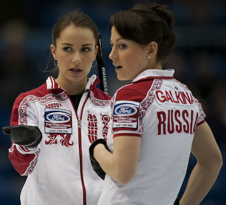 Russia's Anna Sidorova, left, and Ekaterina Galkina ponder strategy during win over Sweden. (Photo, CCA/Michael Burns)