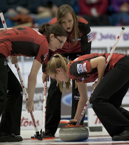 Saint John N.B.Mar21_2014.Ford World Woman's Curling Championship.Canada skip Rachel Homan,lead Lisa Weagle,second Alison Kreviazuk.CCA/michael burns photo