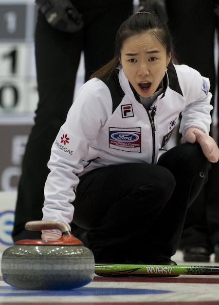 South Korean skip Ji-sun Kim shouts instructions to sweepers during bronze-medal game. (Photo, CCA/Michael Burns)