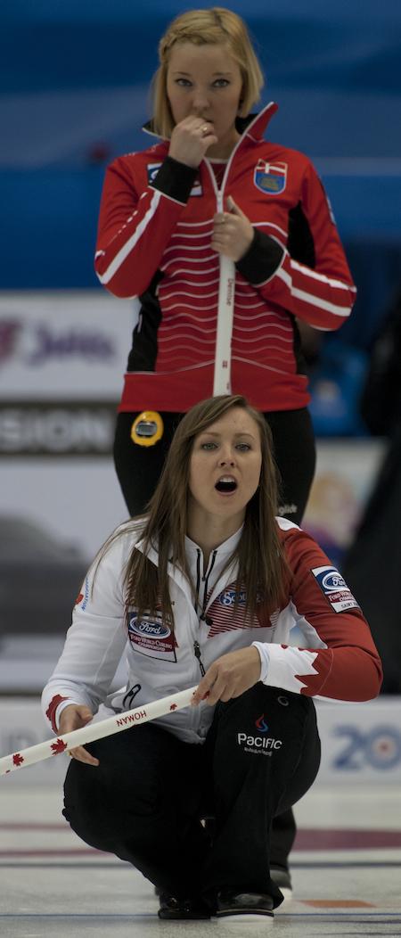 Team Canada skip Rachel Homan guides her sweepers as Denmark's Christine Svensen looks on. (Photo, CCA/Michael Burns)