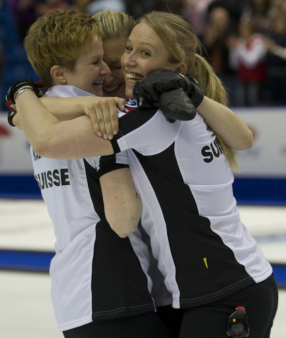 Swiss teammates, from left, Franziska Kaufman, Christine Urech and Irene Schori celebrate their win over South Korea in the semifinal. (Photo, CCA/Michael Burns)