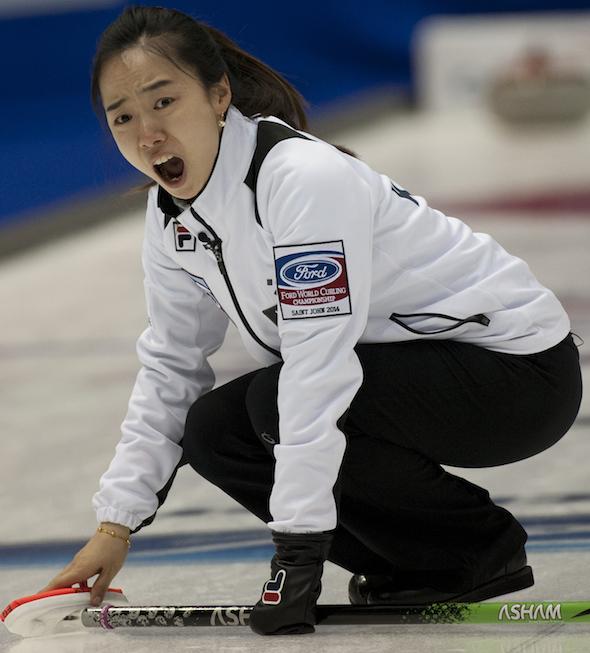 South Korean skip Ji-sun Kim urges her teammates to sweep harder during win over Switzerland. (Photo, CCA/Michael Burns)