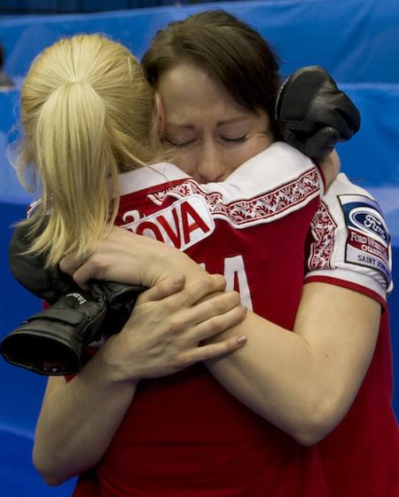 Russian teammates Alexandra Saitova, left, and Ekaterina Galkina embrace after their win on Sunday. (Photo, CCA/Michael Burns)