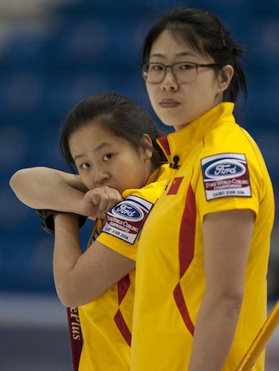 Chinese skip Jinli Liu, right, and teammate Rui Wang look on during win over Latvia. (Photo, CCA/Michael Burns)