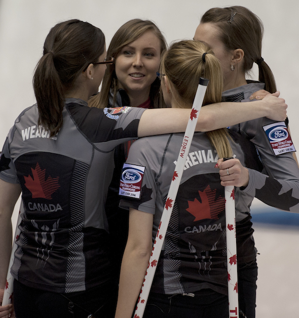 Team Canada celebrates its win over Germany at the 2014 Ford Worlds in Saint John, N.B. (Photo, CCA/Michael Burns)