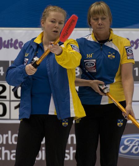 Sweden skip Margaretha Sigfridsson, left, and vice-skip Maria Prytz discuss strategy. (Photo, CCA/Michael Burns)