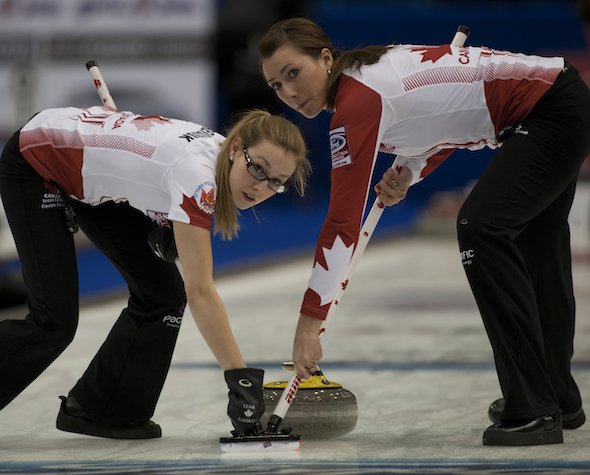 Team Canada's Alison Kreviazuk, left, and Emma Miskew go to work during win over China on Thursday. (Photo, CCA/Michael Burns)