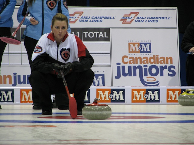 Emma Miskew, then a second-year university student, holds the broom for skip Rachel Homan at the 2009 M&M Meat Shops Canadian Junior Curling Championships in Salmon Arm, B.C. (CCA Photo)