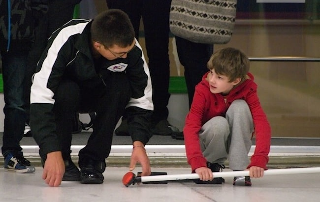 Encouraging a new junior curler at the Juan de Fuca Curling Centre Open House (Photo Doug Butler)