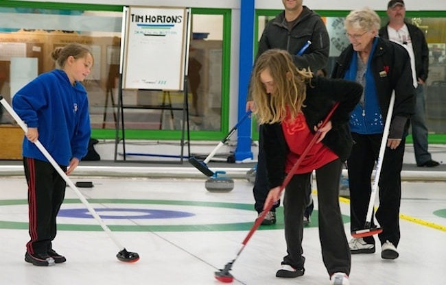 "Juan de Fuca Curling Centre's Sheet 5 is the Tim Hortons ""Draw to the Button"" sheet, where $10 gift cards are given to novice curlers at the annual Open House (Photo Doug Butler)"