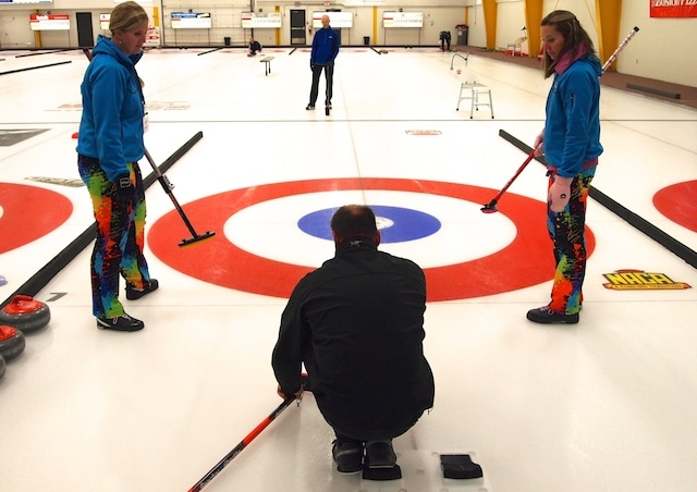 Curlers practice under the watchful eye of their coach (Photo Lisa Shamchuk)