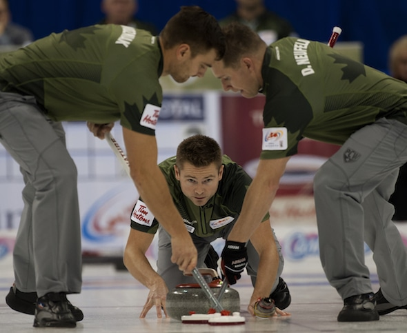 From left, Matt Wozniak, Mike McEwen and Denni Neufeld, along with B.J. Neufeld (not pictured) are off to a torrid start to the 2014-15 season. (Photo, CCA/Michael Burns)