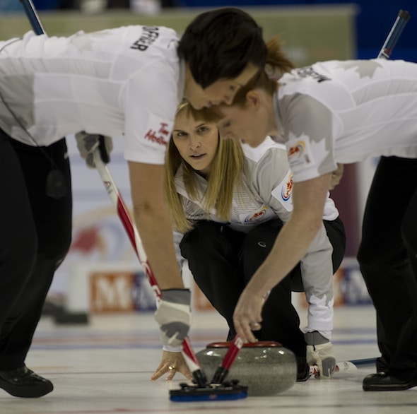 Winnipeg's Jennifer Jones, middle, with teammates Jill Officer, left, Dawn McEwen and Kaitlyn Lawes (not pictures) won the Grand Slam Curlers Corner Autumn Gold on Monday in Calgary. (Photo, CCA/Michael Burns)