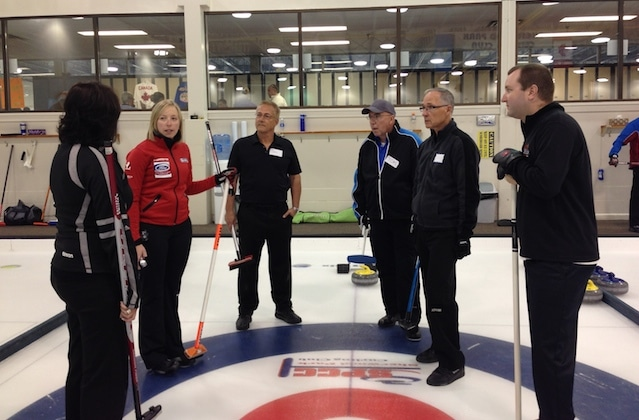 Beth Iskiw gives feedback to a group of adult curlers at the Pros in the Park Curling Camp (Photo courtesy H. Nedohin)