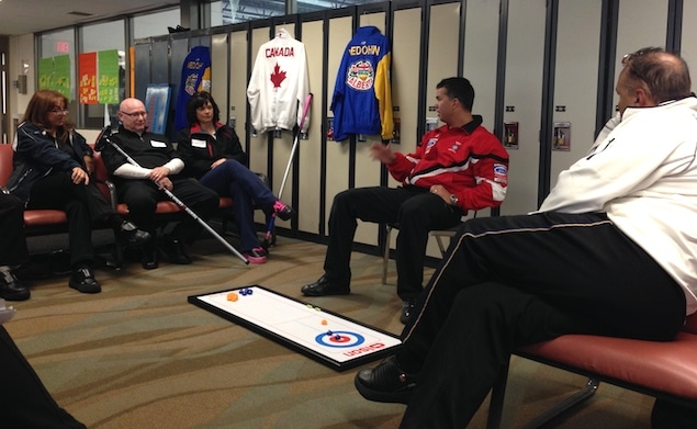 Former Brier and World champions David Nedohin (centre) and Randy Ferbey (right) provide strategy tips during a session at the Sherwood Park Curling Club (Photo courtesy H. Nedohin)