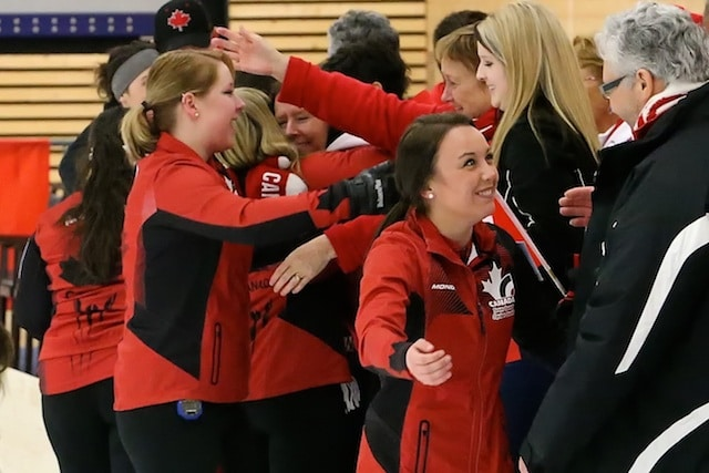 Team Canada skip Kelsey Rocque celebrates with teammates, family and fans after winning the gold medal at the 2014 World Junior Curling Championship in Flims, Switzerland (Photo WCF/Richard Gray)