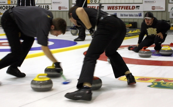 Skip Matt Dunstone, right, instructs sweepers Dan Grant, left, and Chris Gallant during action this past weekend in Morris, Man. (Photo, Brian Chick)