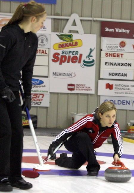 Skip Breanne Meakin delivers her rock, with sweeper Jessica Armstrong ready to scrub. (Photo, Brian Chick).