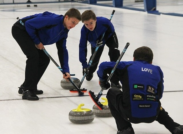 Vernon's Thomas Love (right) calls off sweepers Johnathan Schwartz (left) and Erik Colwell during Sunday afternoon's B final at the Prestige Hotels Rick Cotter Memorial Junior Curling Classic at the Vernon Curling Club (Photo by Roger Knox/Morning Star)
