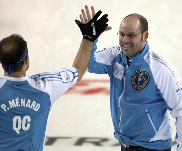 Jean-Michel Ménard, right, and brother Philippe Ménard combined to win a World Curling Tour event in Clermont, Que. (Photo, CCA/Michael Burns)