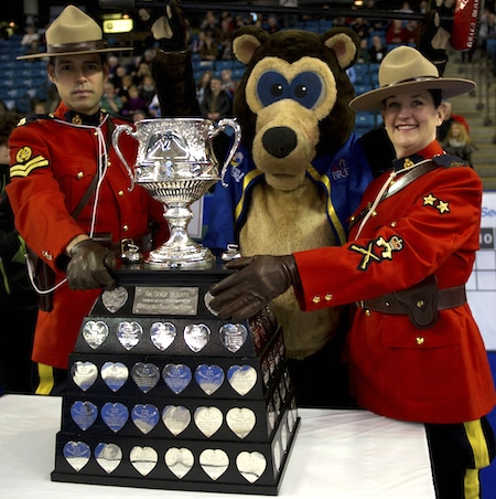 RCMP officers and Brier Bear show off the Tim Hortons Brier Tankard. (Photo, CCA/Michael Burns)