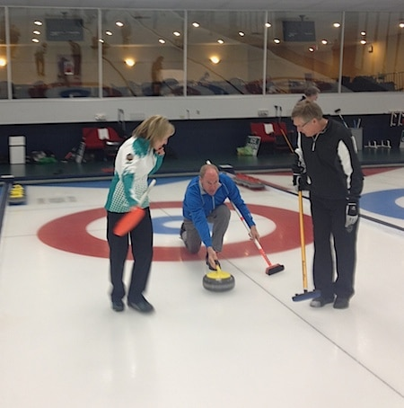 Amy Nixon joins Glencoe curler Kevan King sweeping for Russ Hall (Photo courtesy Jack Moss)