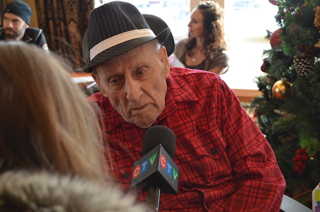 Saskatchewan's 1955 Brier champ, Lloyd Campbell, is interviewed by local media at his 100th birthday celebration on Jan. 4 (Photo courtesy the Campbell family)