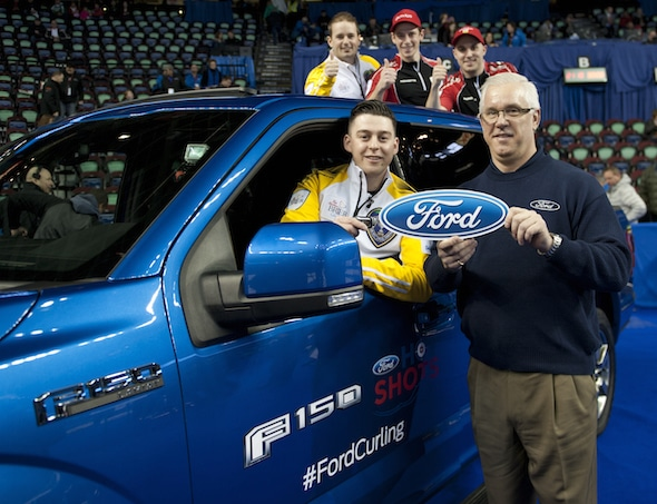 2015 Ford Hot Shots winner Colin Hodgson, left, accepts the keys to a 2015 Ford F-150 pickup from Saskatchewan's Kirk Muyres, left, accepts the keys to a Ford Fusion from Gerald Wood, General Manager, Western Region for Ford of Canada, on Saturday. (Photo, Curling Canada/Michael Burns)